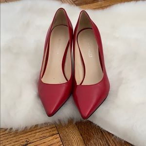 Red leather pumps